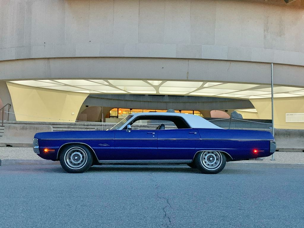 "This 1971 Plymouth Sport Fury 4dr HT has 87k mi, 383 w/4bbl, dual exh., a/c, vinyl roof, light grp, & n/c opt. charcoal cloth/blk vinyl.The color is ""Mood Indigo"" (GC8), a 1-yr, Fury-exclusive."