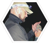 Dr. Markus Mika, Utah Field Team Leader, measures and records data on a Flammulated Owl.