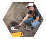 Paleontology fieldwork: an Earthwatch volunteer at the Arlington Archosaur Site in Texas