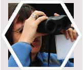 Volunteer collecting animal census data