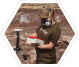 An Earthwatch volunteer volcanologist measuring gas emissions