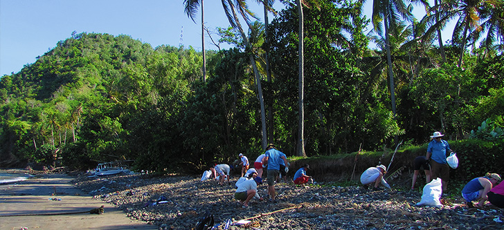Participants surveying up a Bali beach to record categories of debris