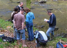 Dr. Gill with students on the river Barle in Devon.