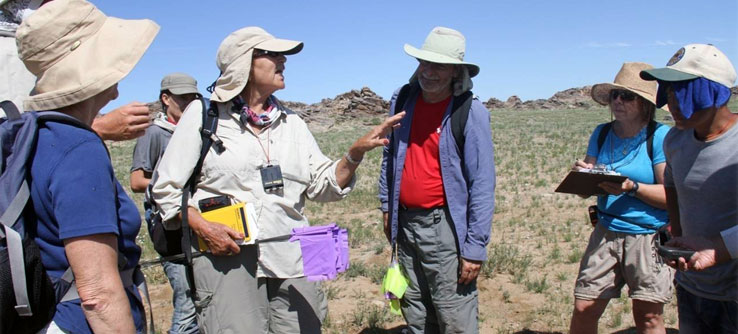 Lead researcher Dr. Joan Schneider directs an archaeological survey.