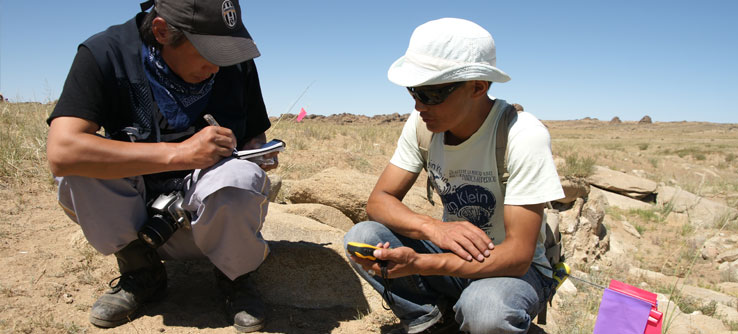 Researchers record the GPS coordinates of an excavation site.
