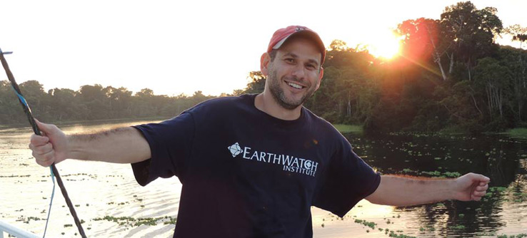 An Earthwatcher enjoys the Amazon sunset in Peru.