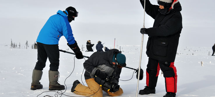 Participants deep into research in the Arctic.