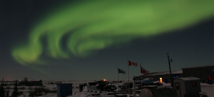 In winter, the northern lights appear over Churchill, Canada.