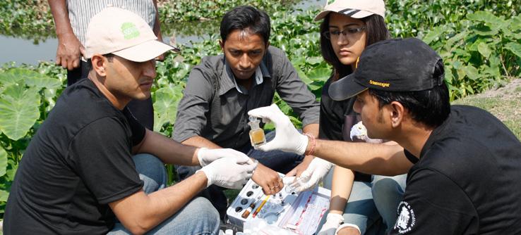 Volunteers take water samples