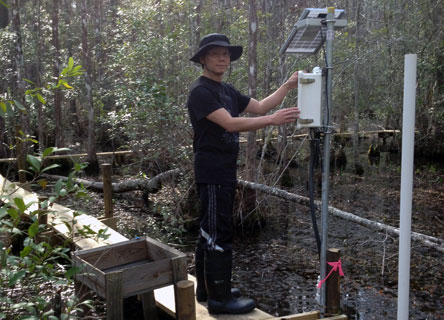 Dr. Chow monitoring water quality and water levels to measure impacts of climate change.