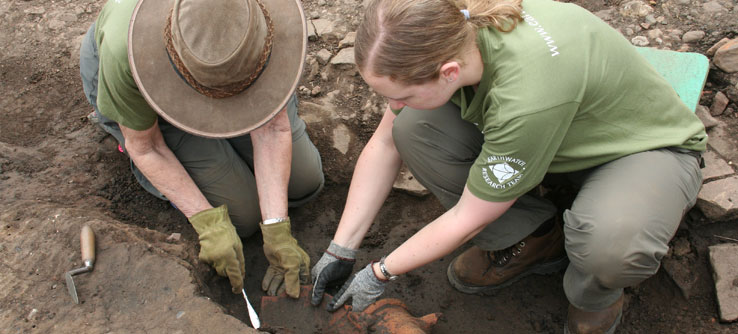 Volunteers excavate pottery at Fort Arbeia.