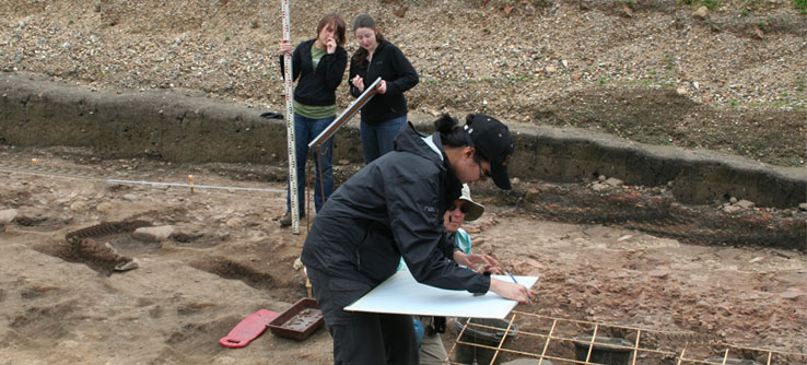 Volunteers map the excavation site to plan for future digs.