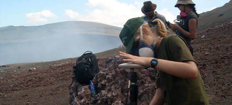 Team members prepare to take gravity measurements near Masaya's crater.