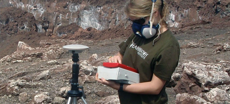 A team member records gravity data in the crater.