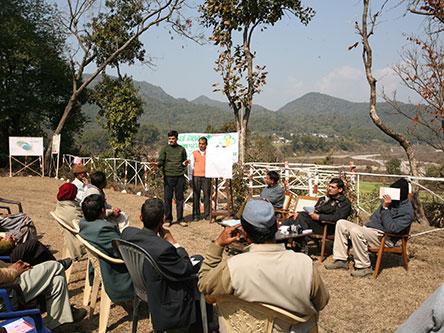 Dr. Harendra Bargali engages with local communities to understand human-wildlife conflict in northern India.