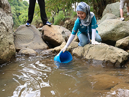 An HSBC Citizen Science Leader collects a water sample in Jakarta
