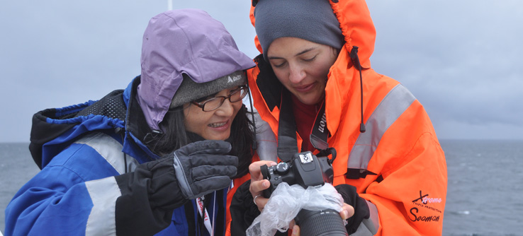 Volunteers with camera, whale watching in Norway