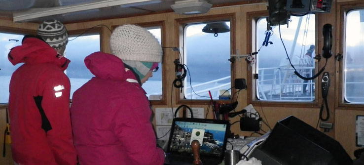 Inside the boat, volunteers take a break from the Arctic weather.