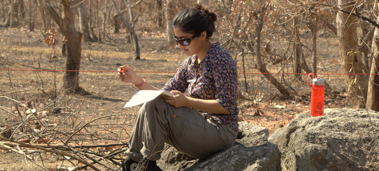 Research notes being taken by a volunteer