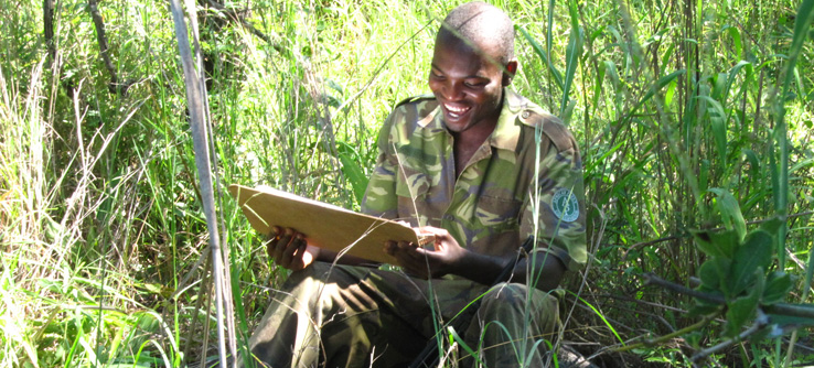 Earthwatch team member recording animal behavior in Majete Wildlife Reserve, Malawi