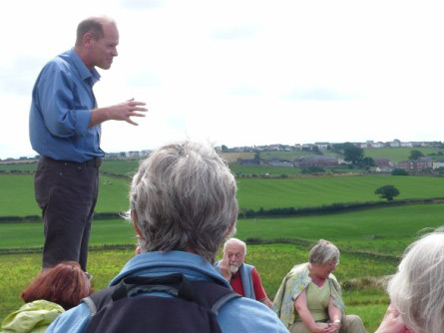 Dr. Nick Hodgson describing the remains of Milefortlet 21 at Swarthy Hill on the Cumberland Coast.