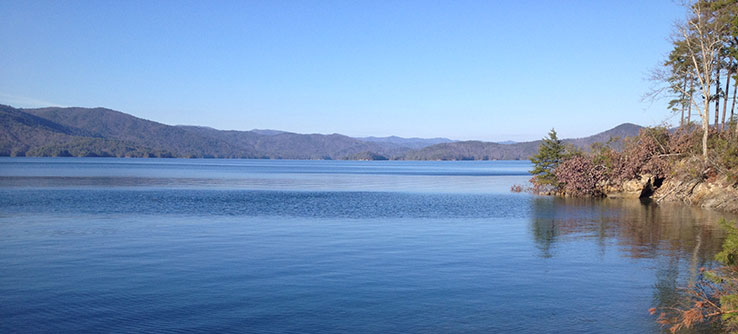 A view of Lake Jocassee, South Carolina with its deep, clear, and pristine water.