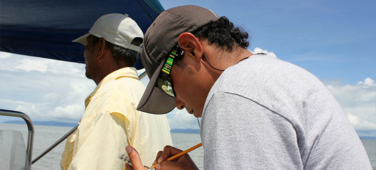 David Herra Miranda records environmental data while Taboga captains the boat.