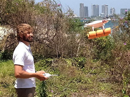Dr Olaf Meynecke piloting a research drone known as the snot collector to collect Whale Spray