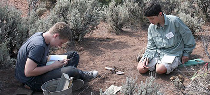 Students record observations during the excavation.