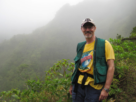 Dr. Thomas Lacher exploring the mountains on Dominica.