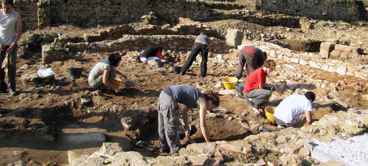 Volunteers work in a room of the Roman villa.