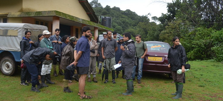 volunteers attend a briefing on the Anuran Amphibians expedition