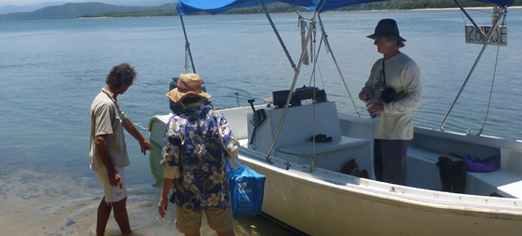 Earthwatch volunteers boarding a boat on the Daintree River coastline, Australia