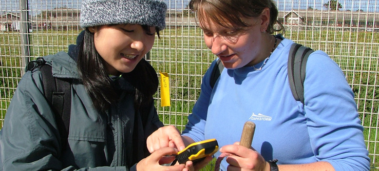 Research volunteers with bird monitoring equipment