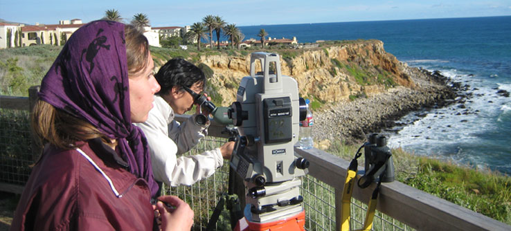 A team member scans the Pacific Ocean for cetaceans.