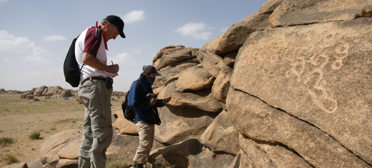 Volunteers studying ancient rock carvings in Ikh Nart Nature Reserve, Mongolia