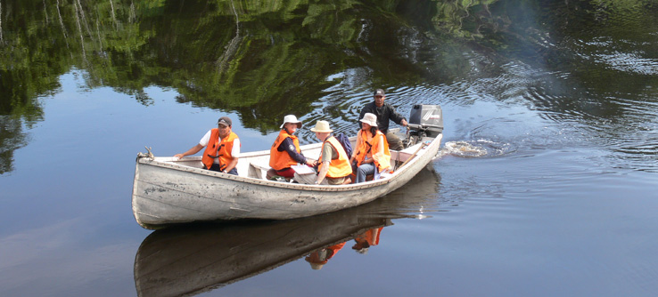 Research volunteers on a boat in the Amazon River, Peru