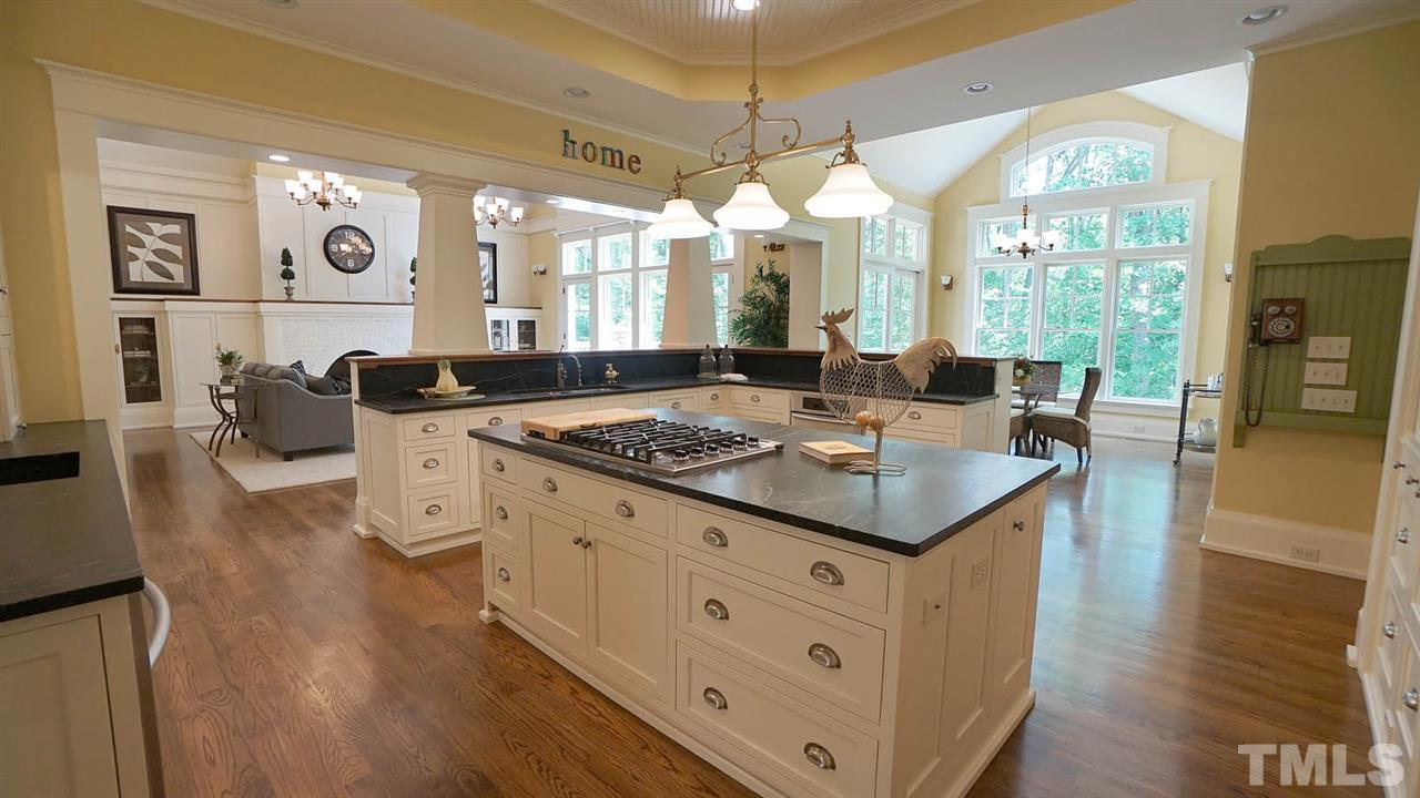 1880's inspired kitchen.  Viking 6 Burner cooktop, 2 kitchen aid wall ovens, Fisher & Pakel dishwasher drawers w/ cabinet facing.  Pot filler w/ separate farmhouse sink & separate dual bowl farmhouse sink.  Soapstone counters, butcher block island