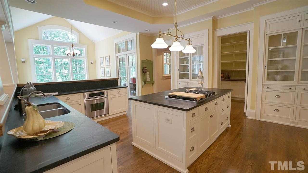 custom cabinetry from CKS Residential, enormous walk in pantry, interior cabinet lighting