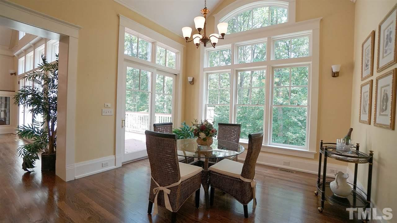 Peaceful private wooded rear views.  Easily sit 8-10 people