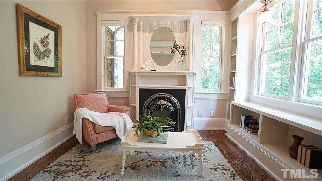 Relax in the separate sitting room w/ a one of kind replica British inspired fireplace.