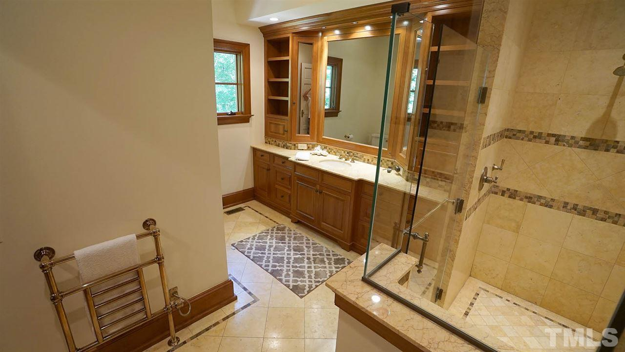 His and her custom furniture quality walk-in closets to die for! Bring your wardrobe!