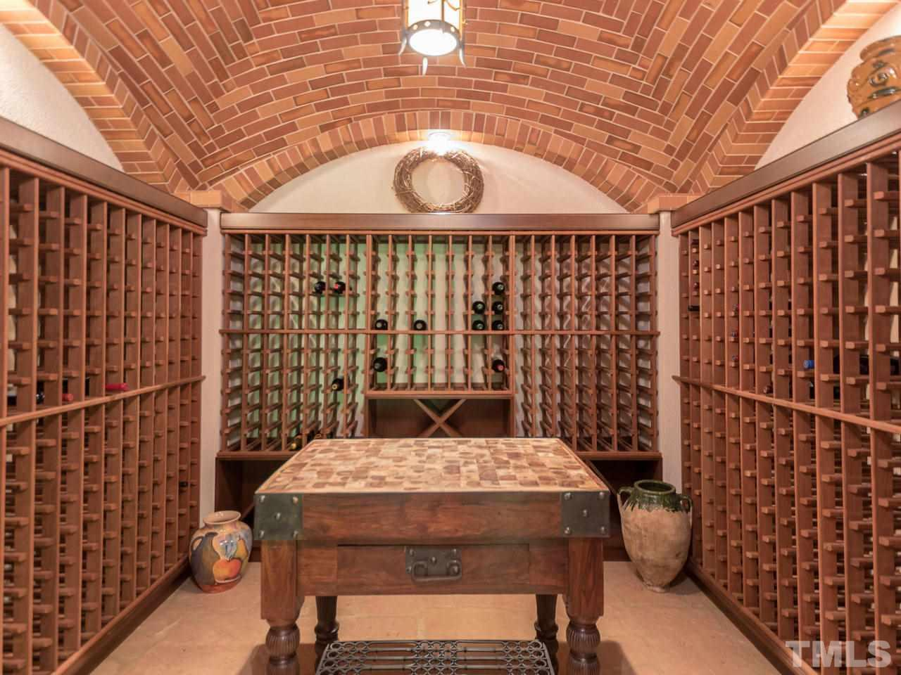 1000+ Bottle conditioned wine room. Custom brick work ceiling, center island for tasting.