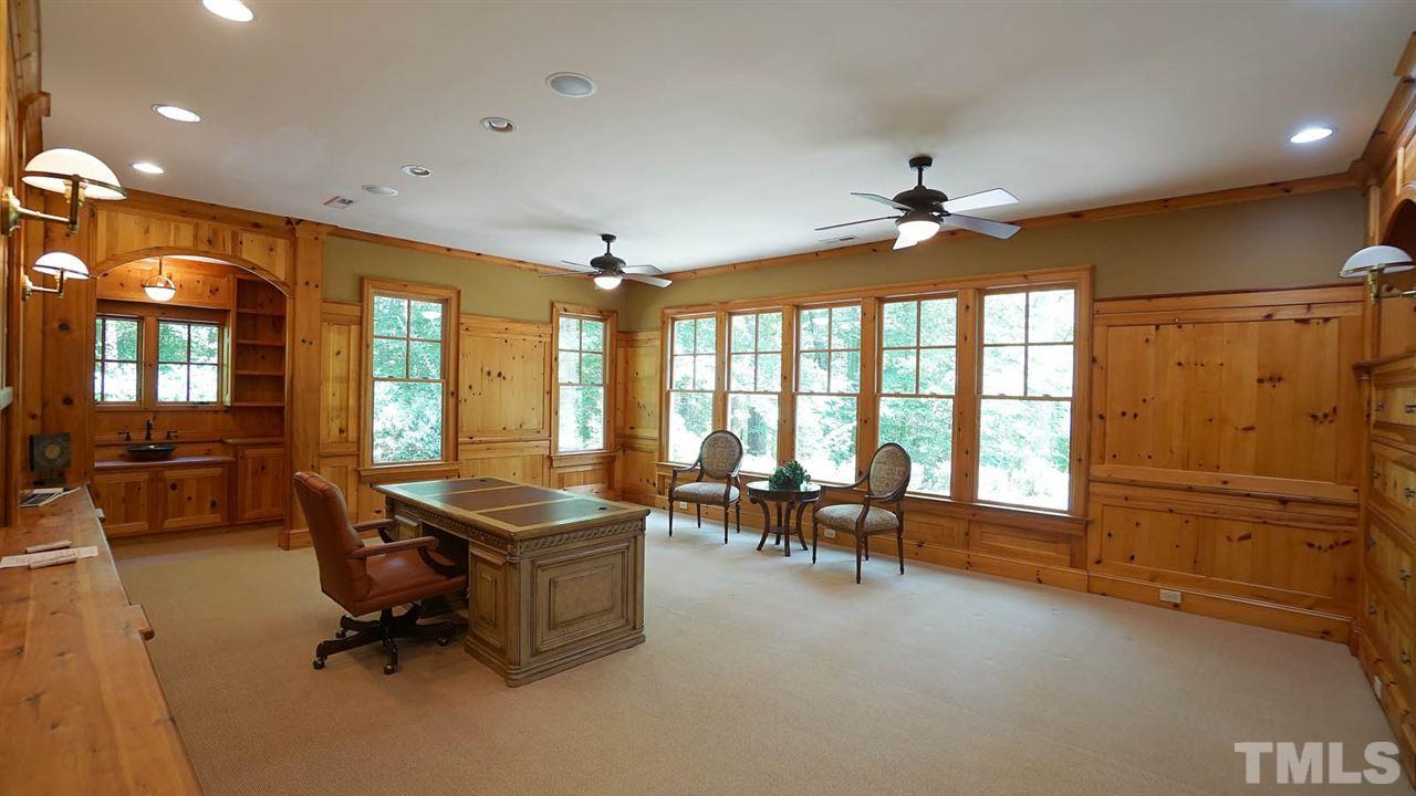 Currently used as an executive office or use as Nanny/teen suite.... it is equal in size to main level master, with built in coffee/wet bar nook & hand crafted vessel sink.  Heart of pine wood accents, extensive built-in shelving and extensive millwork