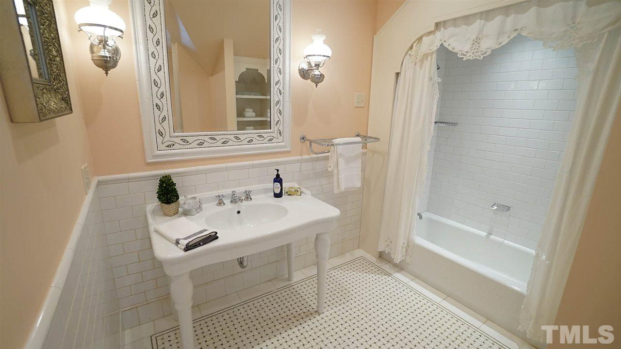 white oversized porcelain vanity/sink, white subway tile walls and accents, and separate water closet