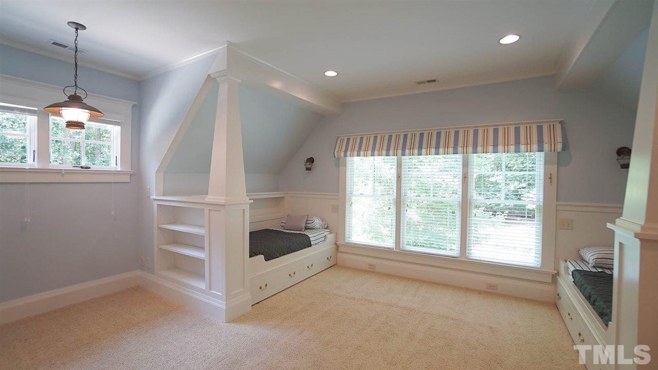 Built in trundle beds and additional built in shelving and spacious walk in closet.  full bath connected