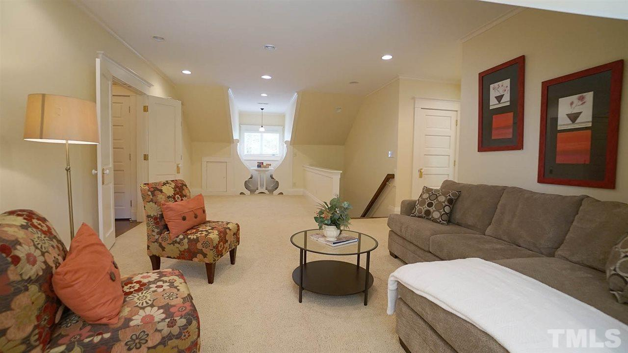 Private access from back stairs or elevator.  One of a kind Inglenook style custom built-in booth, large walk in closet, and window nook with twin size built in bed.  Conveniently located next to second floor kitchen. Perfect separate floor living area.