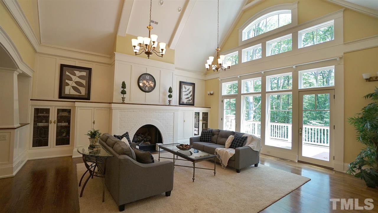 Soaring ceilings, with the feel of a quaint bungalow, extensive millwork throughout, wainscoting, board and batten molding, intricate built -ins, unique storage niches.