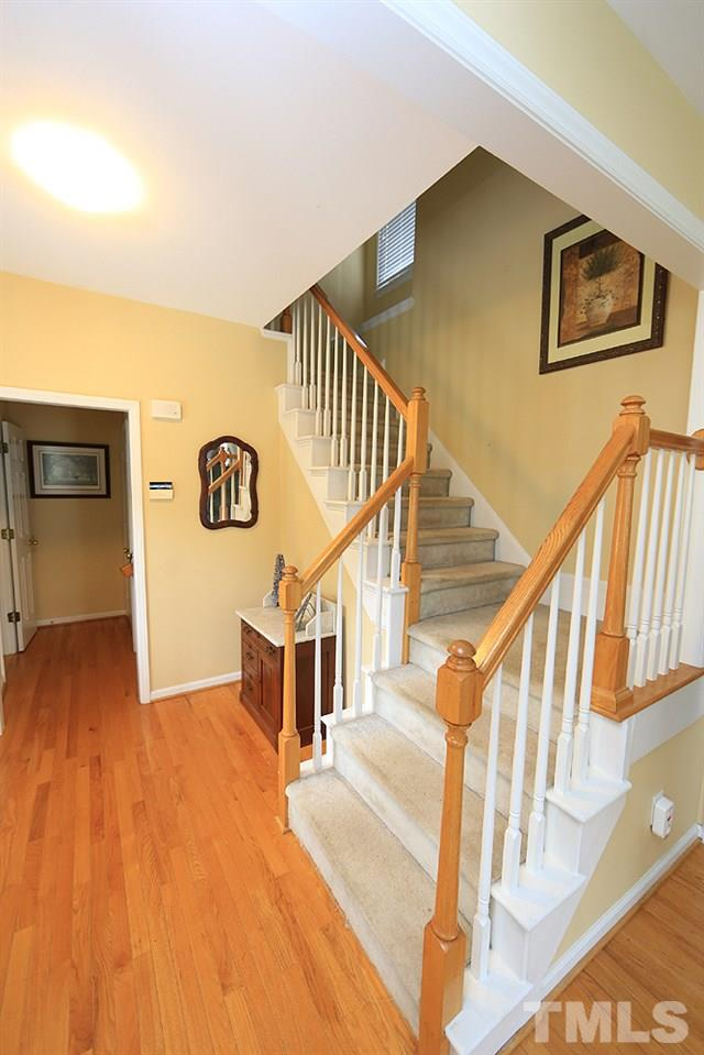 Walk into a foyer that leads to family room and upstairs.  Half Bath to the left, storage and garage to the left