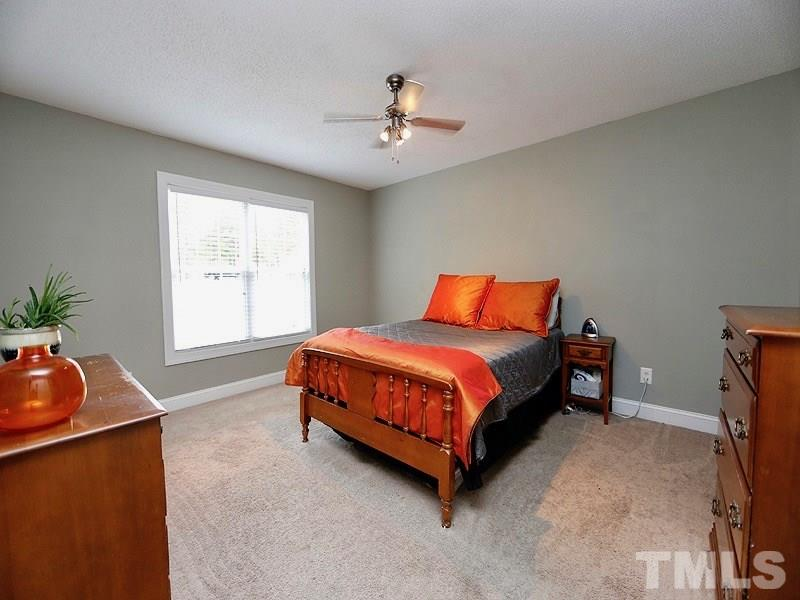 Large master bedroom large enough for a king sized bed and plenty of furniture.
